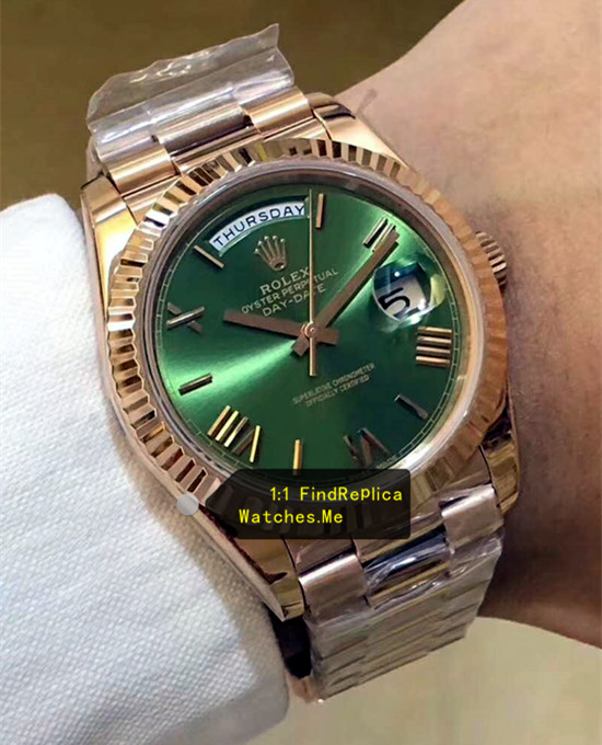 Fake Rolex Daydate 228235 Olive green Face on the Wrist